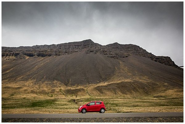 A small red rental car in Iceland