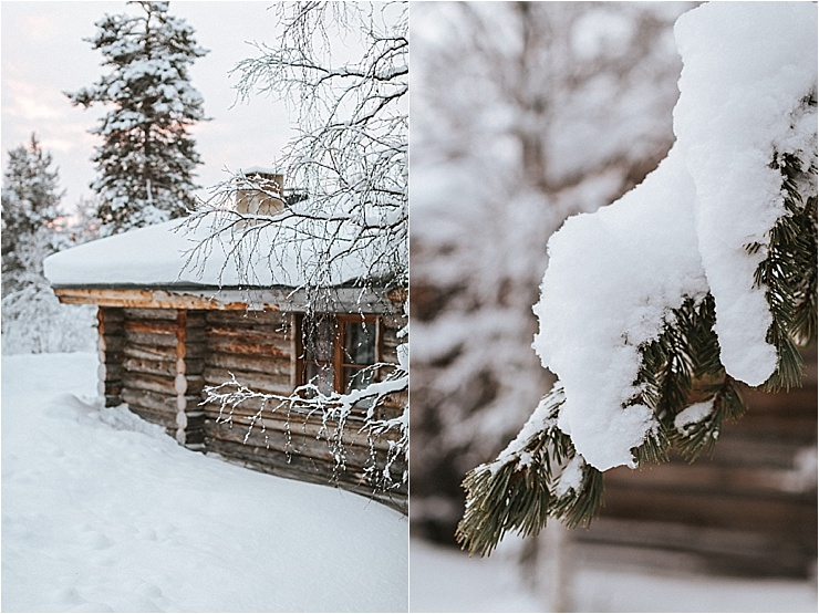 Snow covers a log cabin in the woods and clings to tree branches by Maria Hedengren Photography