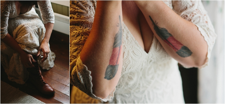 Close up photos of the bride putting on her brown leather boots and her feather tattoos in Lofoten Norway by Thomas Stewart