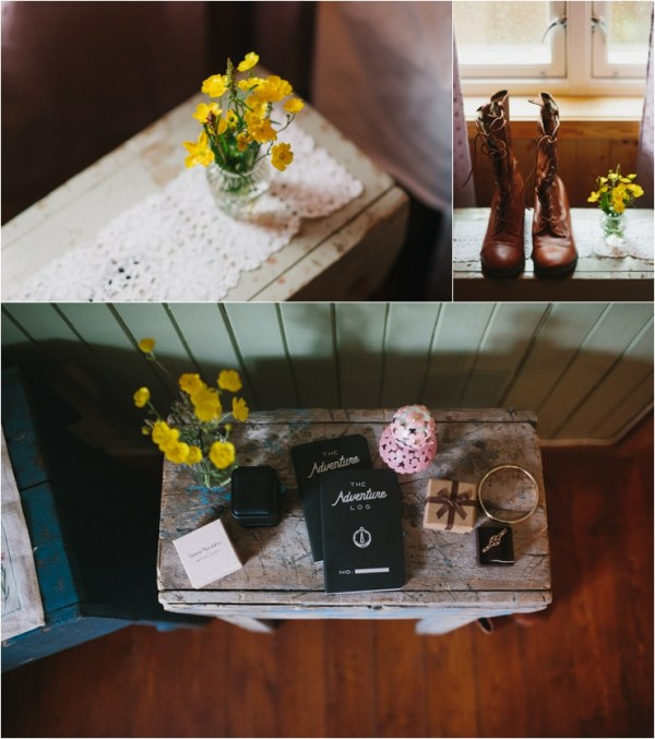 Wild flowers sit on a table along with the wedding details for a Lofoten elopement in Norway by Thomas Stewart