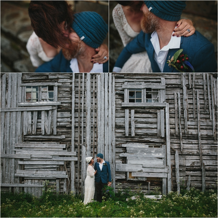 Bride and groom kiss outside a wooden hut in Lofoten Norway by Thomas Stewart