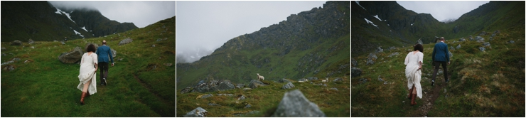 Maz and Dave hike up to their ceremony location in the mountains in Lofoten Norway by Thomas Stewart