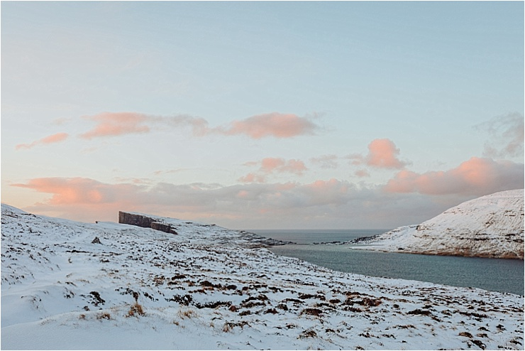 Hiking along Lake Leitisvatn at sunrise in the Faroe Islands on We Are The Wanderers