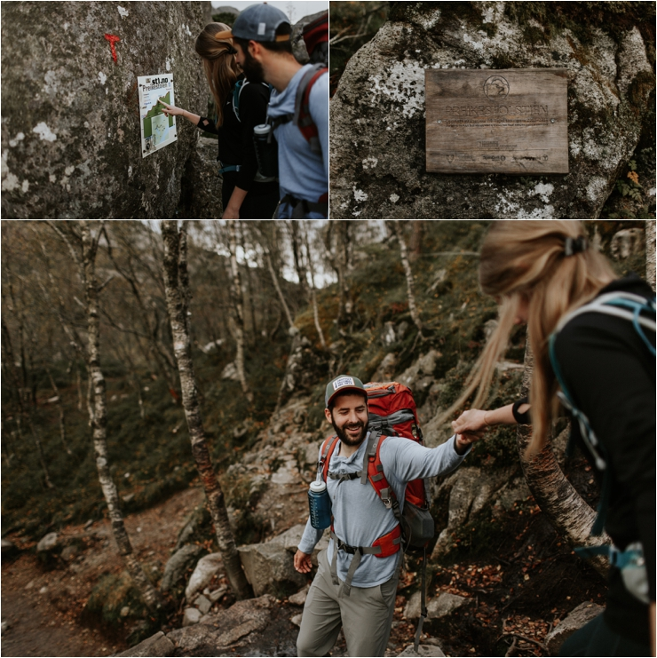 Tyler helps Becky down some rocks on their hike to to Preikestolen in Norway by Aspen Jeanne Photography