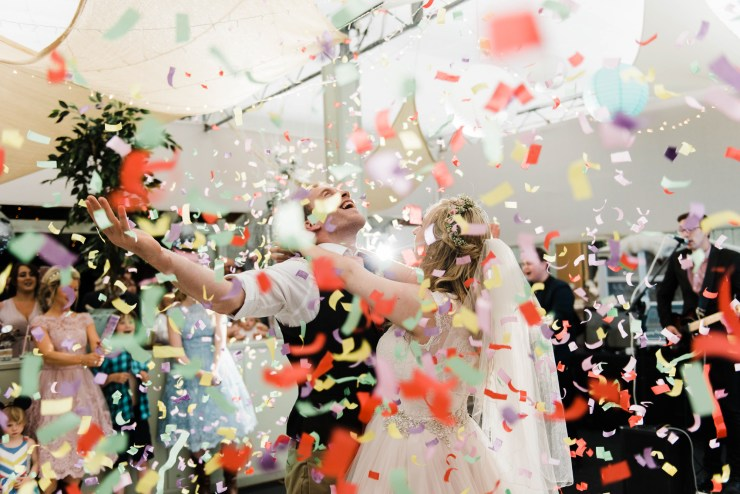 Confetti canons during the bride & groom's first dance by Folega Photography