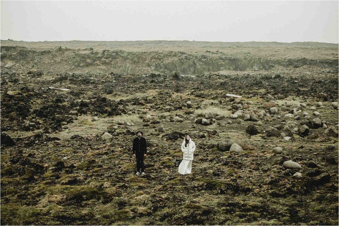 Gaby and German stand in front of the rift valley on the Reykjanes peninsula for their Iceland anniversary shoot by Projectphoto.ch