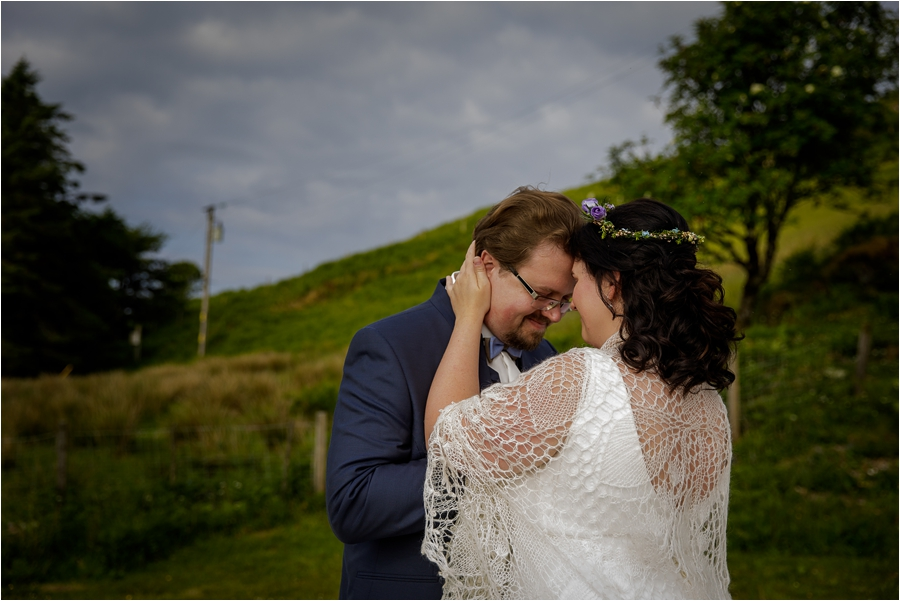 Tina & Jürgen embrace during their first look before their Loch Coruisk Elopement On The Isle Of Skye by Lynne Kennedy Photography