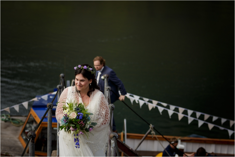 Disembarking the boat for their Loch Coruisk Elopement On The Isle Of Skye by Lynne Kennedy Photography