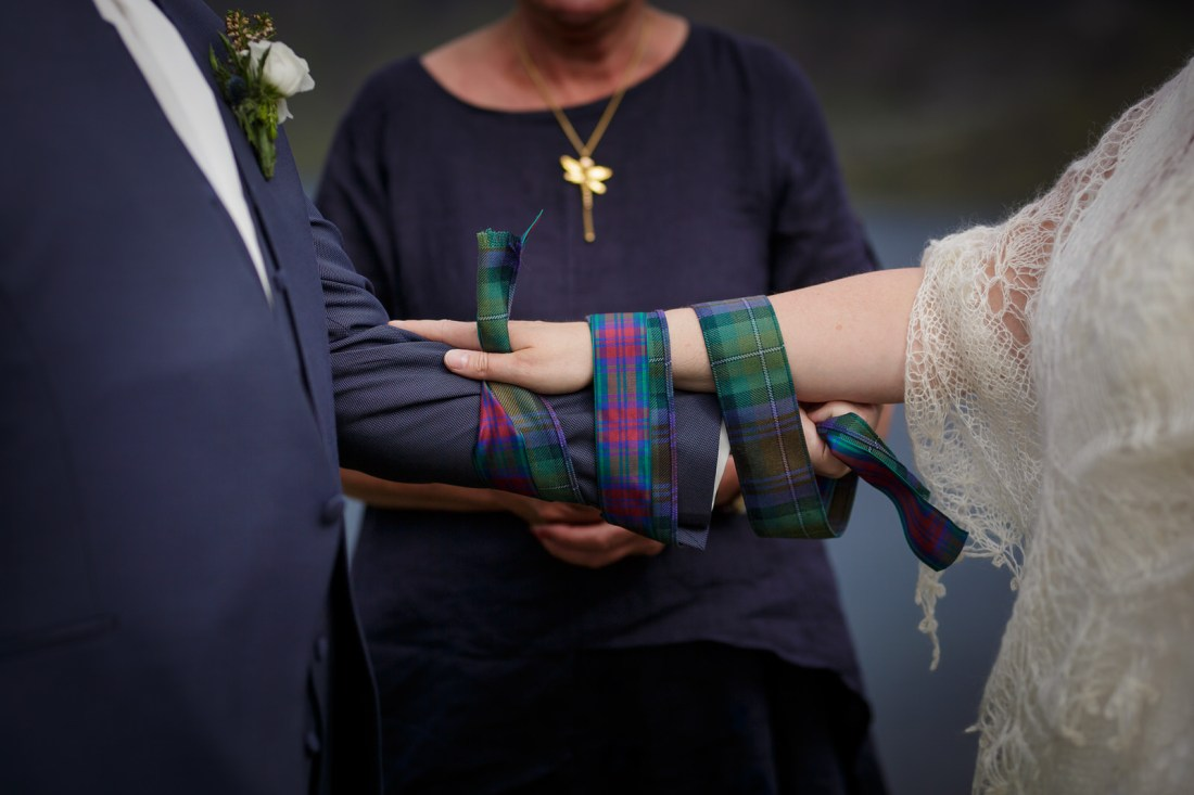 A handfasting ceremony on Loch Coruisk by Lynne Kennedy Photography