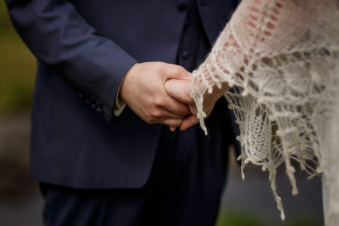 Tina & Jürgen hold hands during their humanist ceremony by Lynne Kennedy Photography