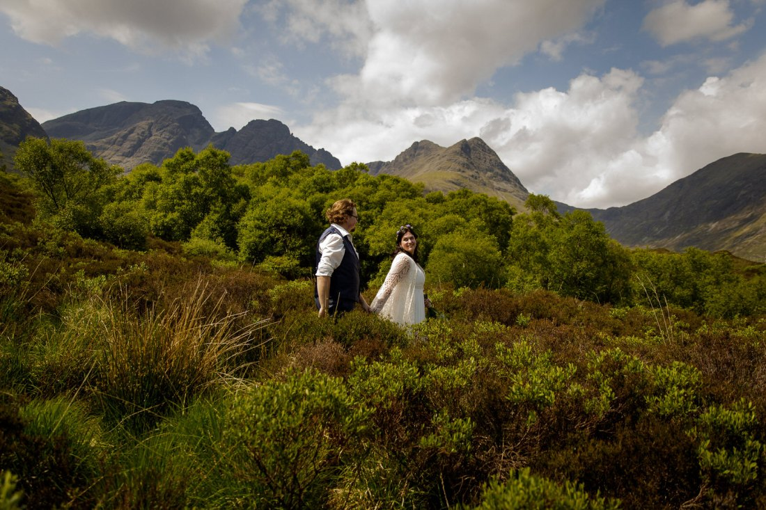 Tina & Jürgen walk through long bushes after their elopement by Lynne Kennedy Photography