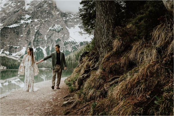 Christina & Ted take a walk around Lago Di Braies for their pre-wedding photoshoot in the Dolomites by Wild Connections Photography