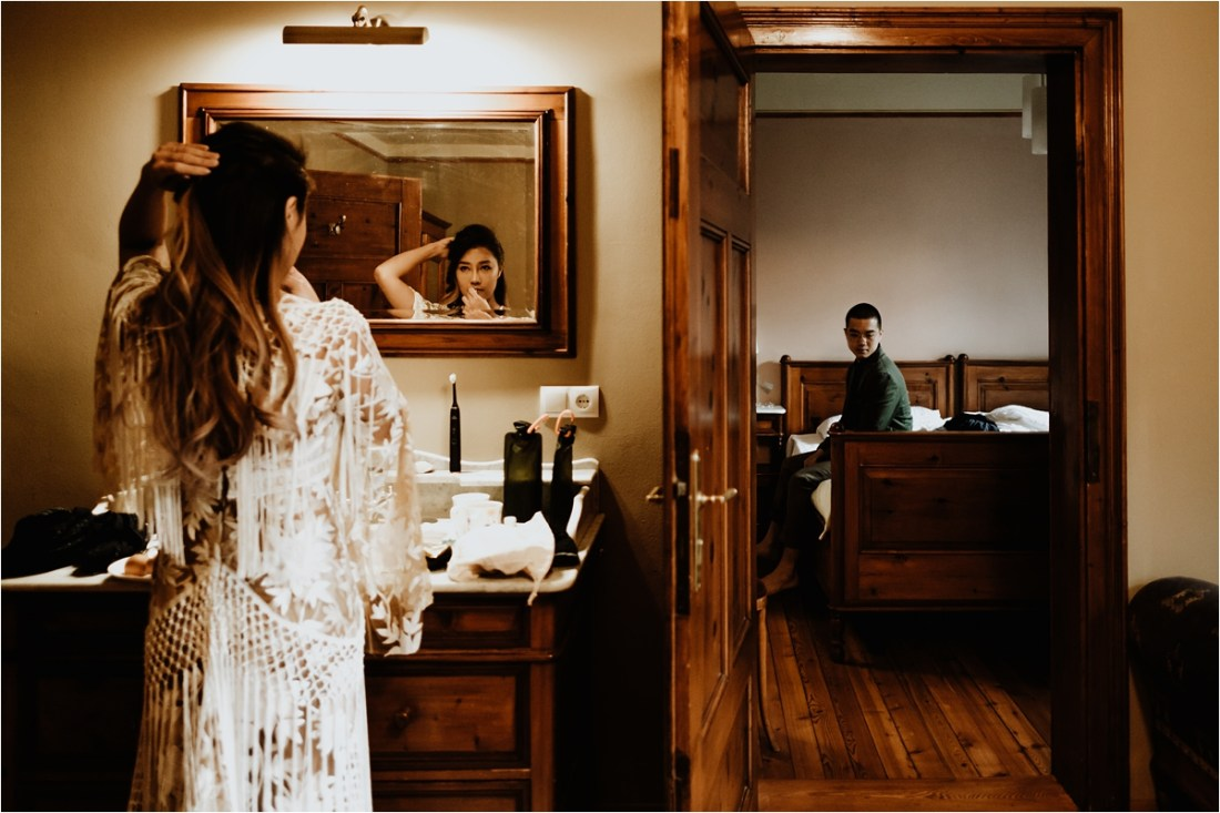 Christina prepares for their pre-wedding shoot at Hotel Lago Di Braies by Wild Connections Photography