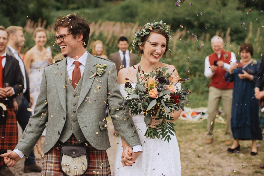Colourful confetti at Sarah & Col's sheep farm wedding in Scotland by Fox & Bear Photography