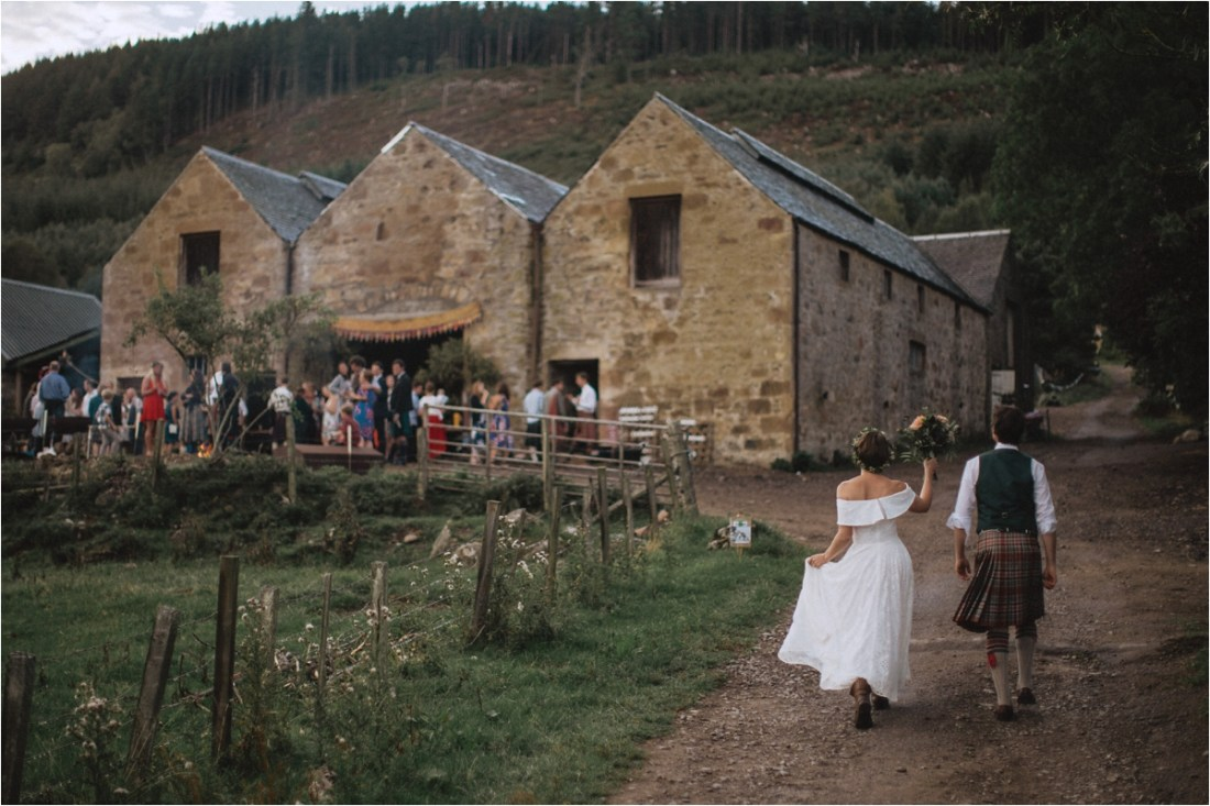 The bride and groom return to the barn for their reception by Fox & Bear Photography