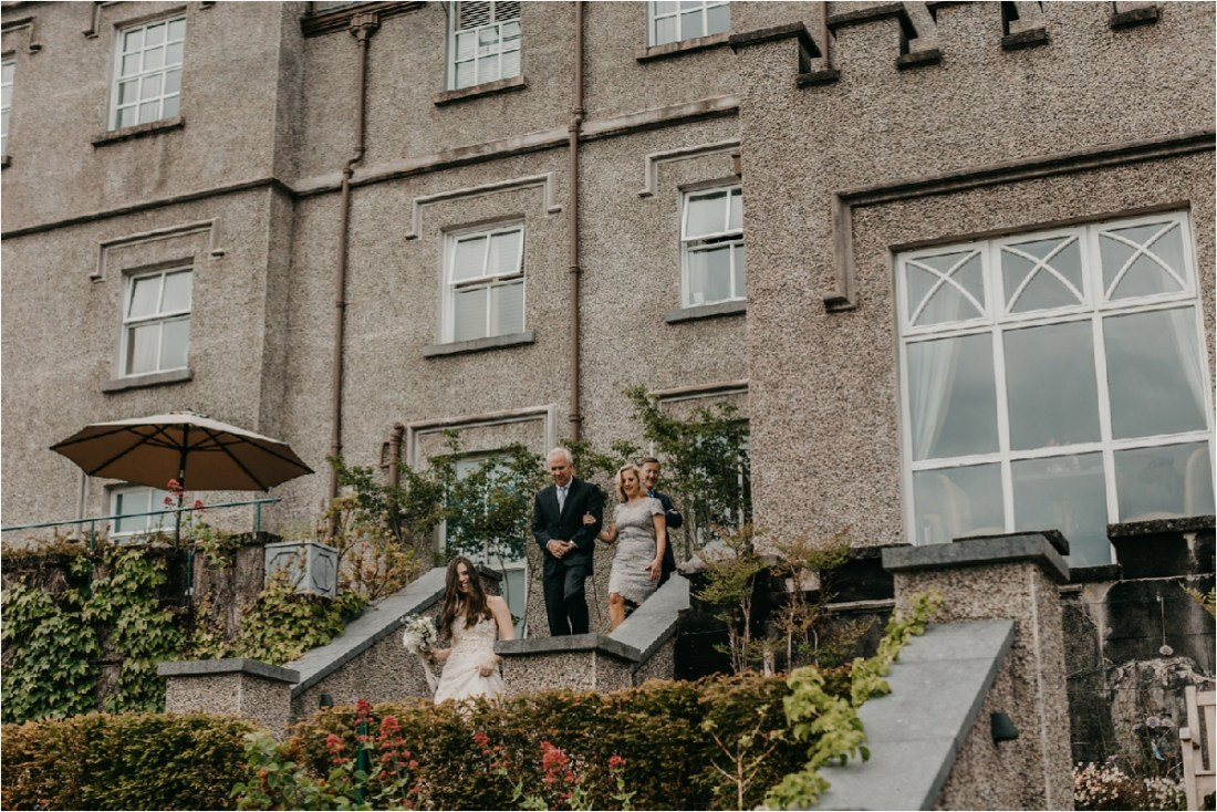 The bride walks herself down the aisle for her wedding at Ballynahinch Castle by No Other Love Photography