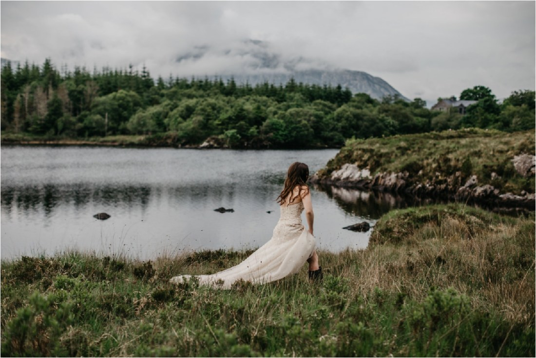 The bride walks around the lake in wellington boots by No Other Love Photography