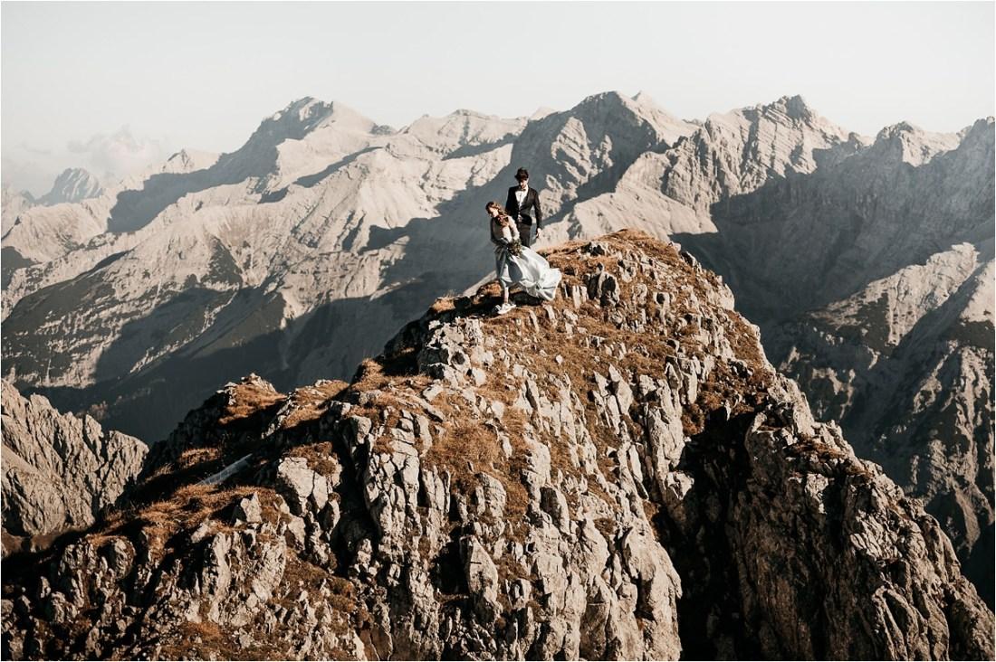 Bride and groom walk along a mountain ridge by Aneta Lehotska