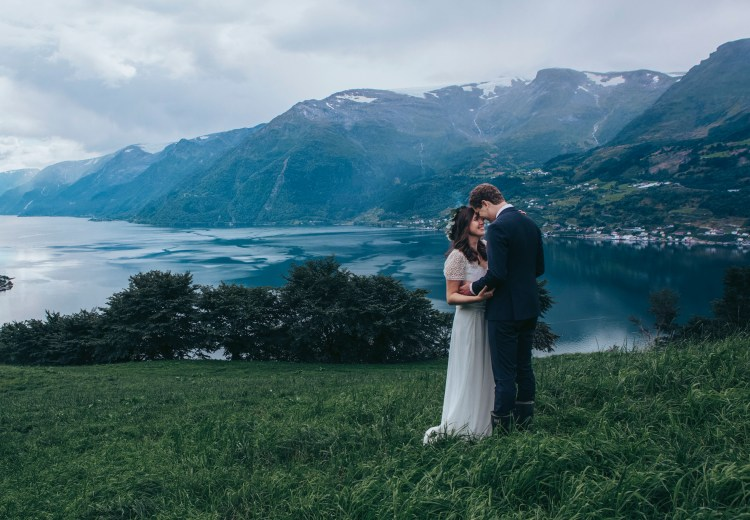 The bride and groom share a quiet moment after their family farm wedding in Hardangar Fjord Norway by Lene Fossdal