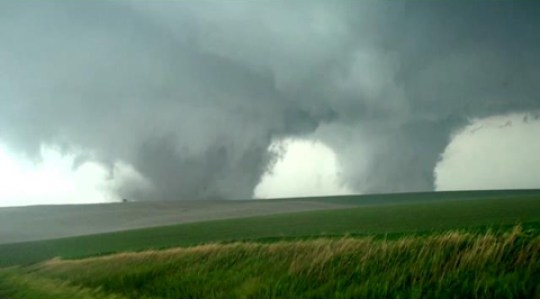 Rare twin tornadoes tear across Nebraska. Image Credit: KEYC