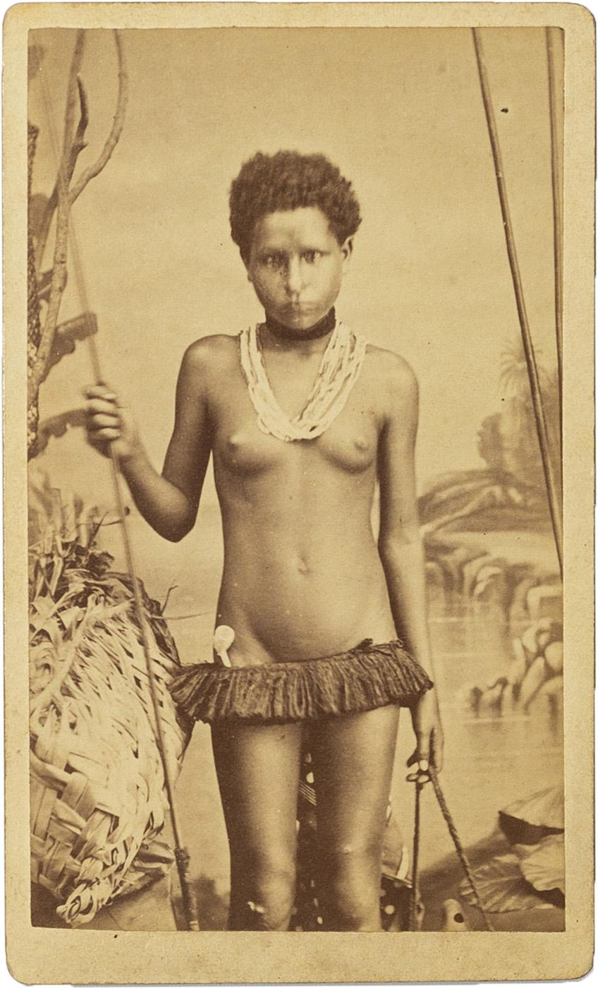 Allan Hughan Portrait of the daughter of Kanak Chief Waton, pipe tucked in skirt, wearing a necklace made of braided hair strings with magical value and necklaces of pearls and shells Carte de Visite Albumen print on Hughan card c1874 104mm x 64mm