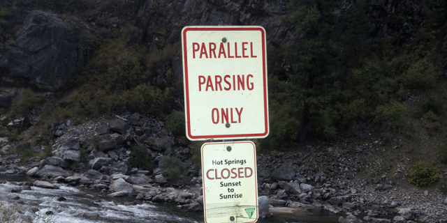 """a road sign that will says """"parallel parsing only"""""""