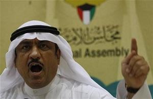 Kuwaiti lawmaker Musallam al-Barrak speaks to journalists at Parliament's media center in Kuwait City