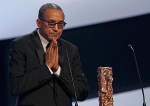 "Director Abderrahmane Sissako reacts next to his trophy after winning the Best Director Award for the film ""Timbuktu"" at the 40th Cesar Awards ceremony in Paris February 20, 2015. REUTERS/Philippe Wojazer (FRANCE - Tags: ENTERTAINMENT)"
