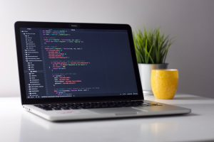 A computer showing source code - Photo by Clément H on Unsplash