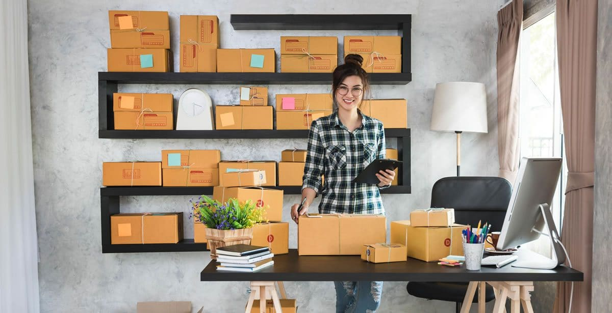Woman with packing boxes