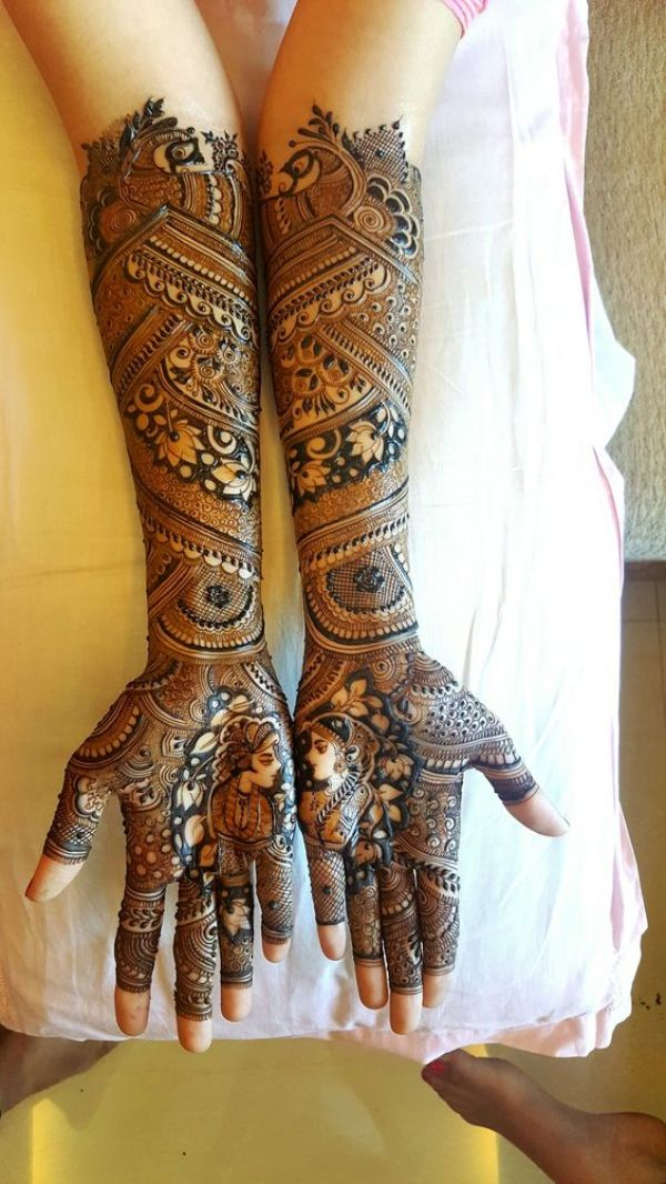 27. Dulhan and Doolha Bridal Mehndi with Lotus Flower