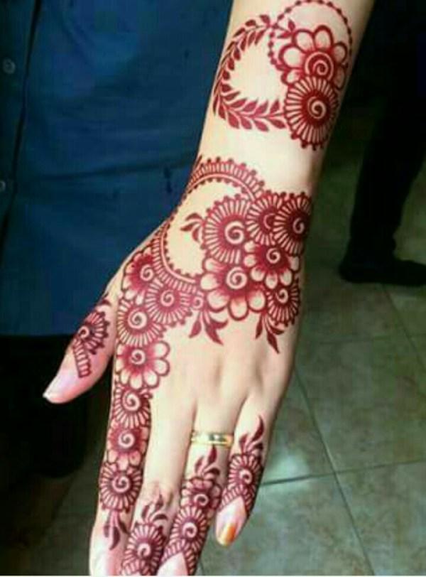 27.Many Flowers red back henna design