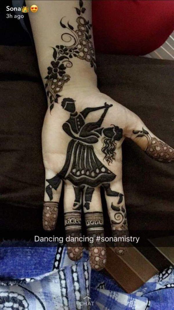 3.Dancing couple mehndi design