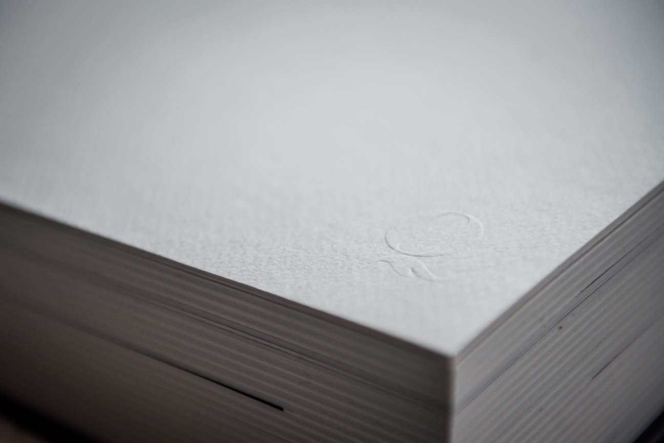 Queensberry albums embossed Q logo on flyleaf