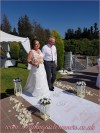 Michell walking down the aisle with her dad on her personalised aisle runner