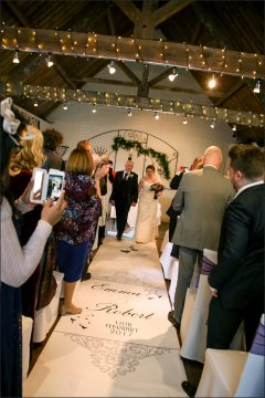 Emma & Robert review their wedding aisle runner