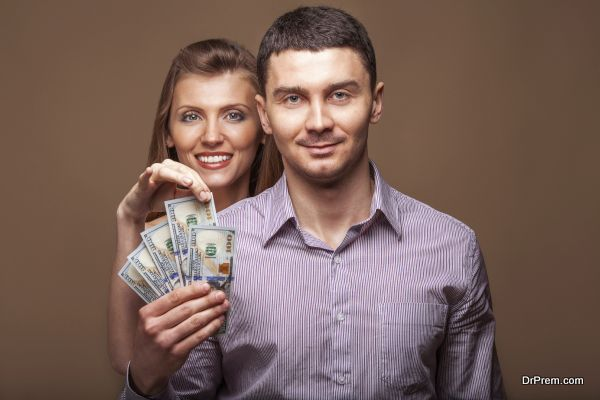 Fashion beautiful couple in love holding money the family budget