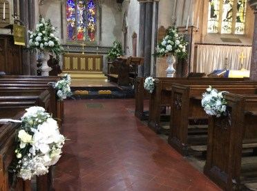 Urn arrangements and pew ends
