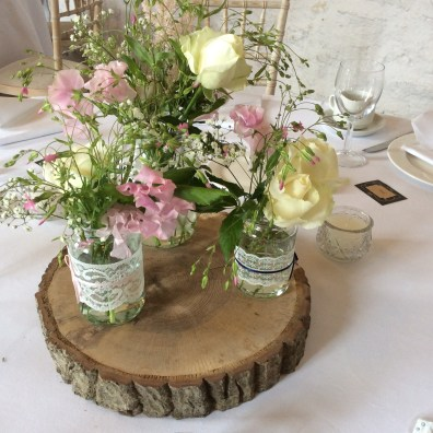 Hired wooden slices and Jam Jar posies