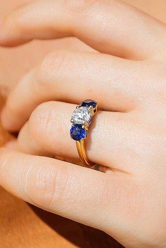 round engagement rings three stones sapphire diamond yellow gold