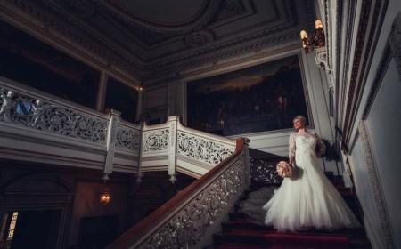 Bride posing on stairwell