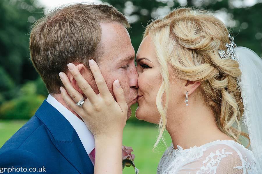 kiss at Thornton Manor wedding