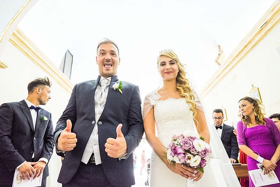 Groom giving thumbs up at the alter