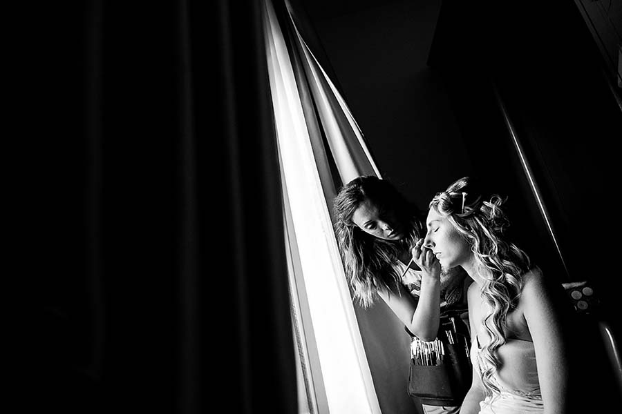 Make up artist getting bride ready in Italy