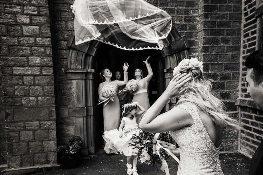 brides veil blowing away