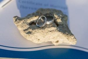 Beautiful Vow renewal couple rings on stone