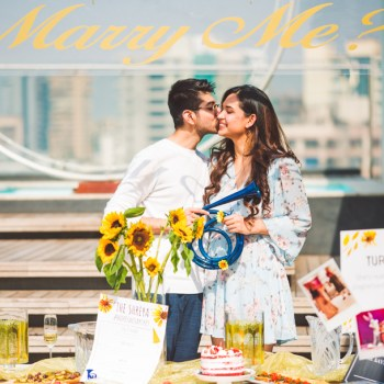 This sun-kissed rooftop proposal with sunflowers and champagne was brimming with 'aww' moments
