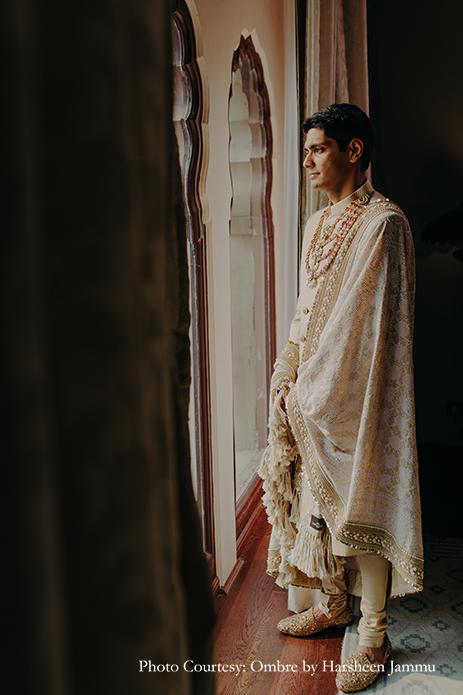 groom in white bandhgala sherwani with shawl