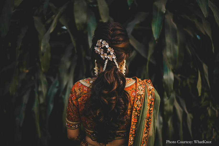 bride wore a vintage lehenga in cream, rust, and olive green hues from Kalista for mehndi