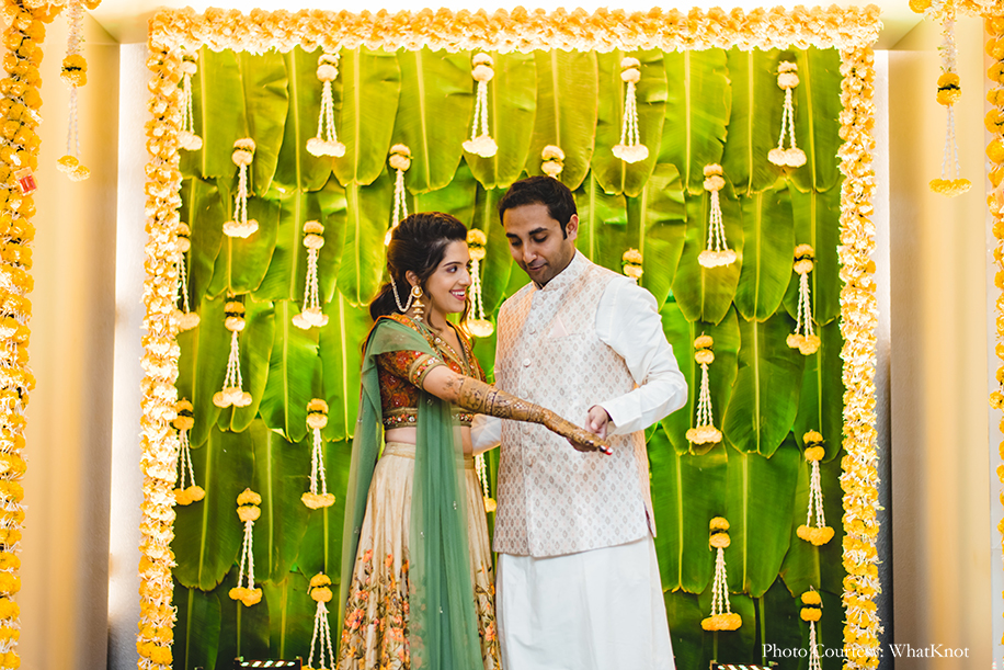 bride wore a vintage lehenga in cream, rust, and olive green hues from Kalista and the groom wore a Manyavar outfit for mehndi